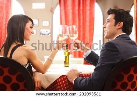 Couple having dinner in a restaurant - stock photo