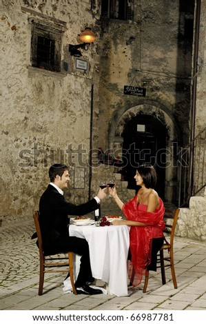couple having dinner in an old rural village