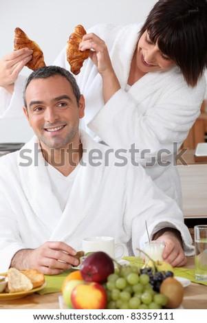 couple having fun at breakfast - stock photo