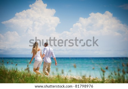 couple having fun at seaside - stock photo