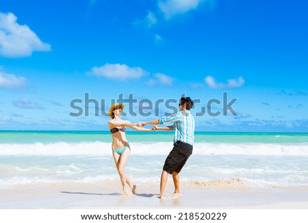 Couple having fun at the beach.  - stock photo