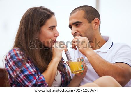 Couple having fun in an outdoor bar - stock photo