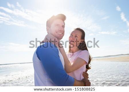 Couple Having Fun On Beach Holiday - stock photo
