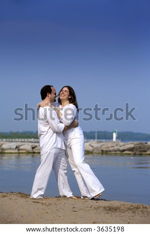 couple having fun on the beach during summer days
