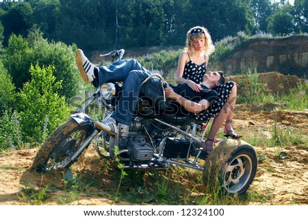 couple having fun outdoors on a motorbike