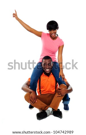 Couple having fun. Studio shot. All on white background