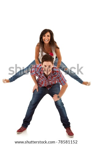 couple having fun - woman jumping on her boyfriend's back - stock photo