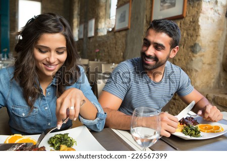Couple having lunch at rustic gourmet restaurant - stock photo