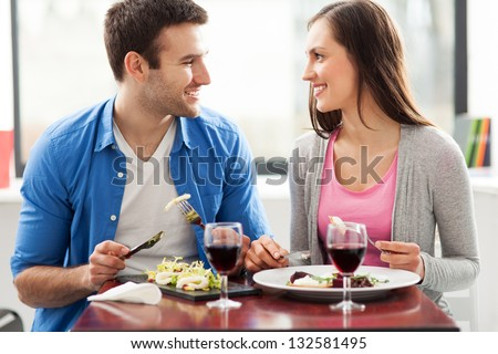 Couple having meal in restaurant - stock photo