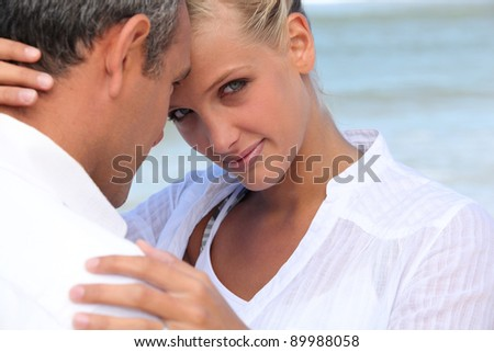 couple heads joined at sea - stock photo