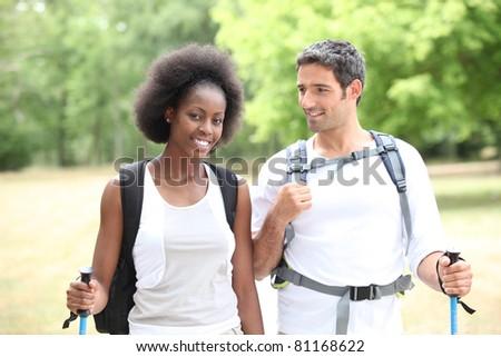 Couple hiking - stock photo
