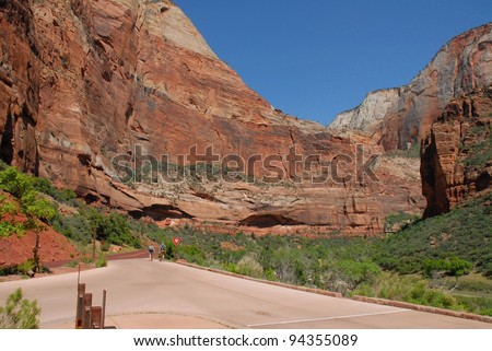 Couple Hiking at Zion National Park Mountain Wall in Utah, USA - stock photo