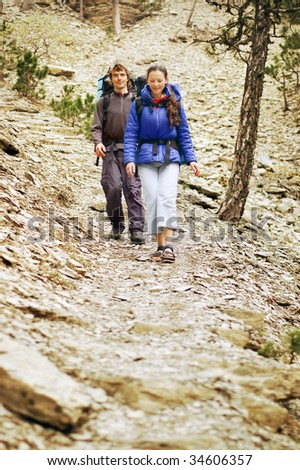 Couple Hiking in Rocky Mountains - stock photo
