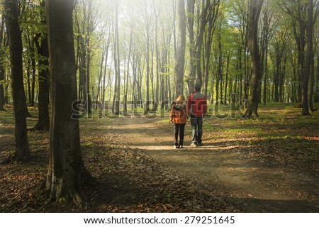 Couple hiking in the forest - stock photo