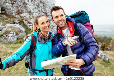 Couple hiking. Using map to get good direction, - stock photo