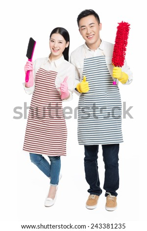couple hold cleaning tool on white background - stock photo