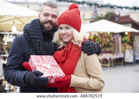 Couple holding a big gift