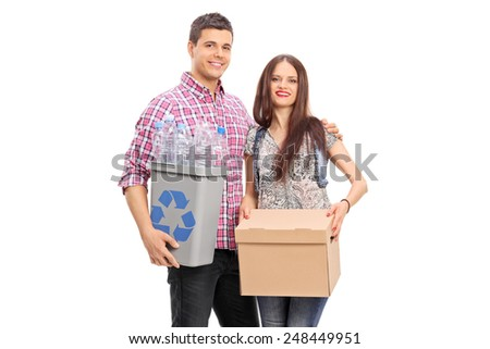 Couple holding a box and a recycle bin isolated on white background - stock photo