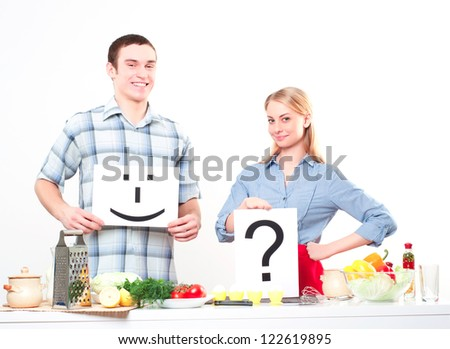 couple holding a plate with signs smile and question - stock photo