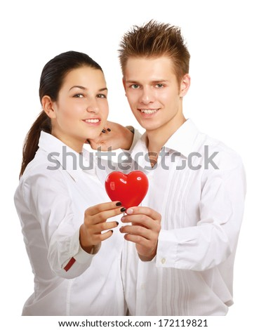 Couple holding a red heart, isolated on white background - stock photo