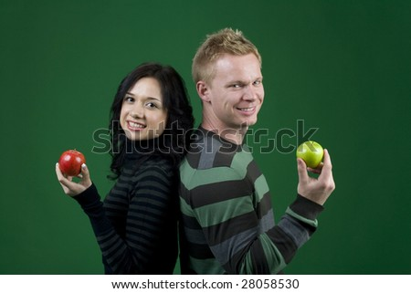 Couple holding apples