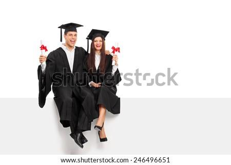 Couple holding diplomas and celebrating graduation isolated on white background - stock photo