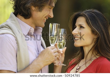couple holding glass of wine - stock photo