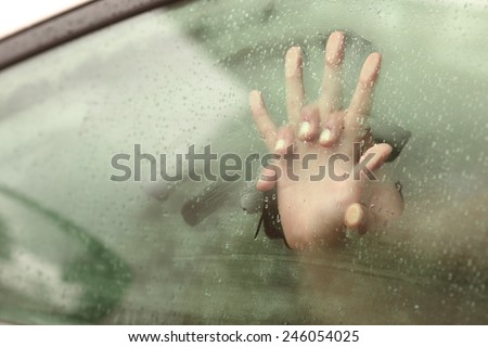Couple holding hands having sex inside a car with a steamy window - stock photo