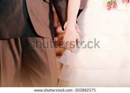 couple holding hands in wedding day - stock photo