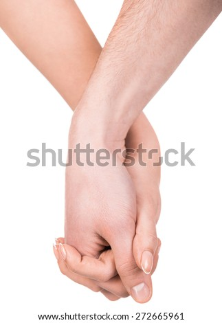 Couple holding hands isolated on white background. - stock photo