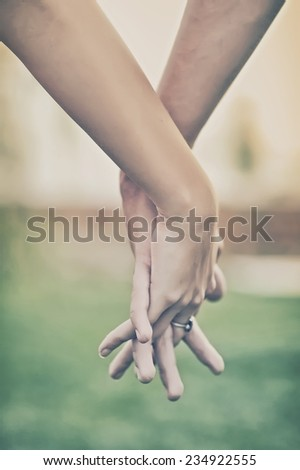 Couple holding hands. Love concept - stock photo
