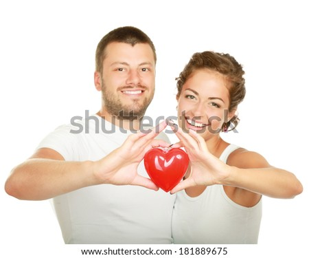 Couple holding red heart , isolated on white background - stock photo