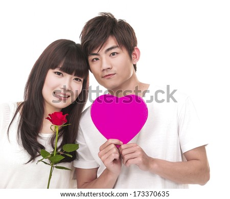 couple holding single rosewith heart box - stock photo