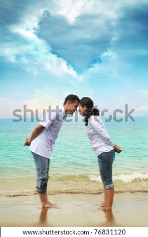 couple honeymoon vacation at beach - stock photo