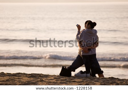 couple hugging and looking at a camera - stock photo