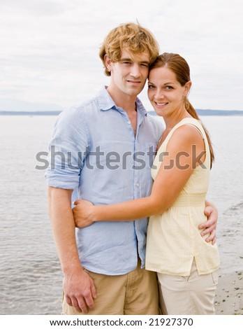 Couple hugging at beach - stock photo