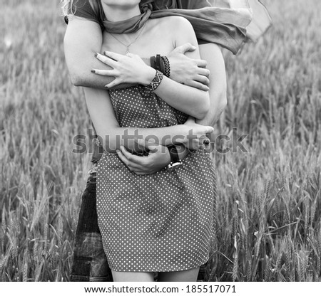 Couple hugging in a green land black and white - stock photo