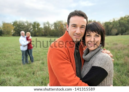 Couple hugging in the countryside - stock photo