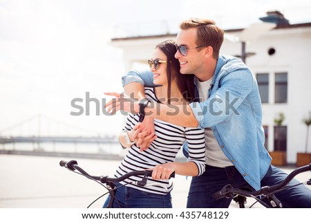 Couple hugging looking in front of it - stock photo