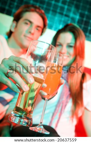 couple in a bar having a drink and smiling - stock photo