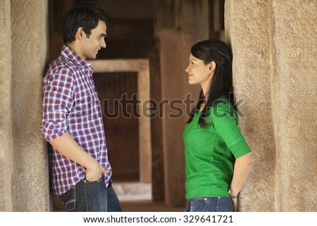 Couple in a fort looking at each other - stock photo