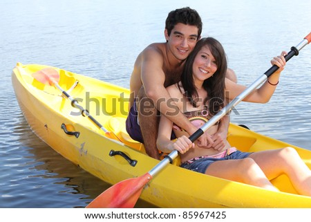 Couple in a kayak - stock photo