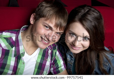 couple in a movie theater, watching a cinema - stock photo
