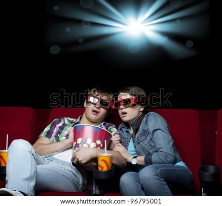 couple in a movie theater, watching a 3-D movie - stock photo