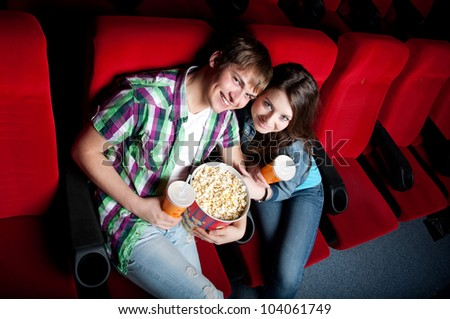 couple in a movie theater, watching movie - stock photo