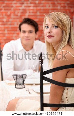 Couple in a restaurant - stock photo