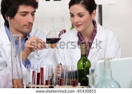 Couple in a wine laboratory - stock photo