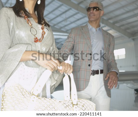 Couple in airplane hanger - stock photo