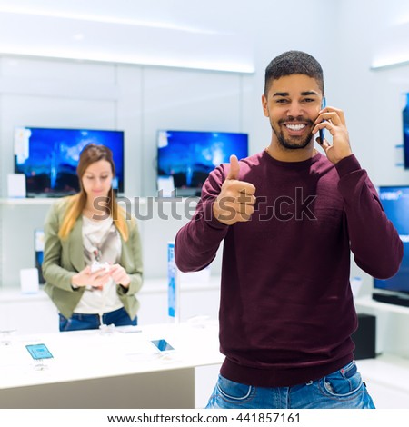 Couple in an appliance store. - stock photo