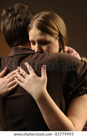 Couple in an embrace on an dark background
